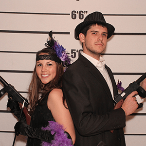 Columbus Murder Mystery party guests pose for mugshots